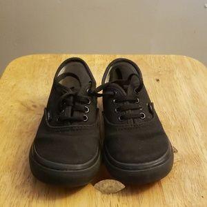 Black low top shoes